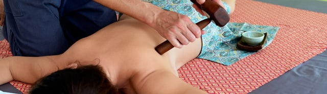 Thai Tok Sen tap massage therapy. Help with back pain, headache, migraine, pain in hip, knee.